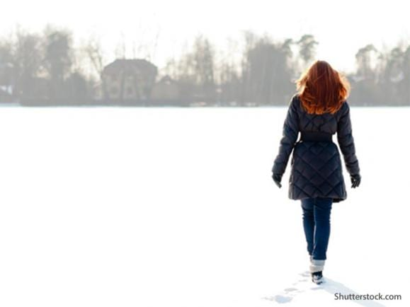 woman walking winter cold
